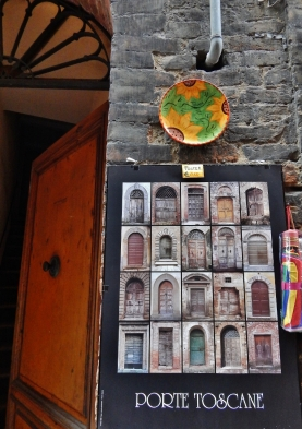 "A door collection on sale in Siena. Norm said: ""You don't need that poster – you could make your own and it would be even nicer."" Thank you!"
